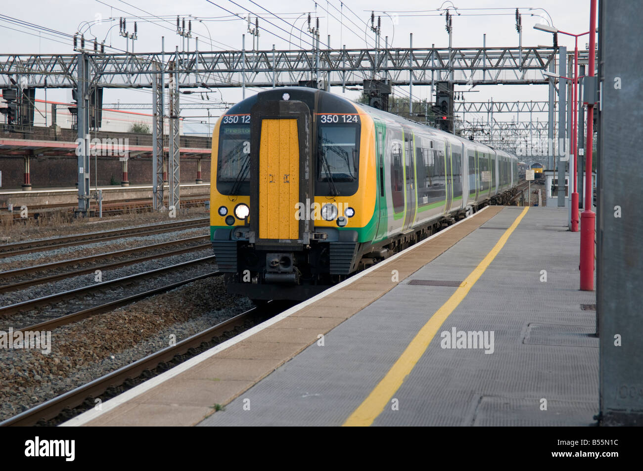 London Midland railway commuter Train at Crewe railway station UK - Stock Image