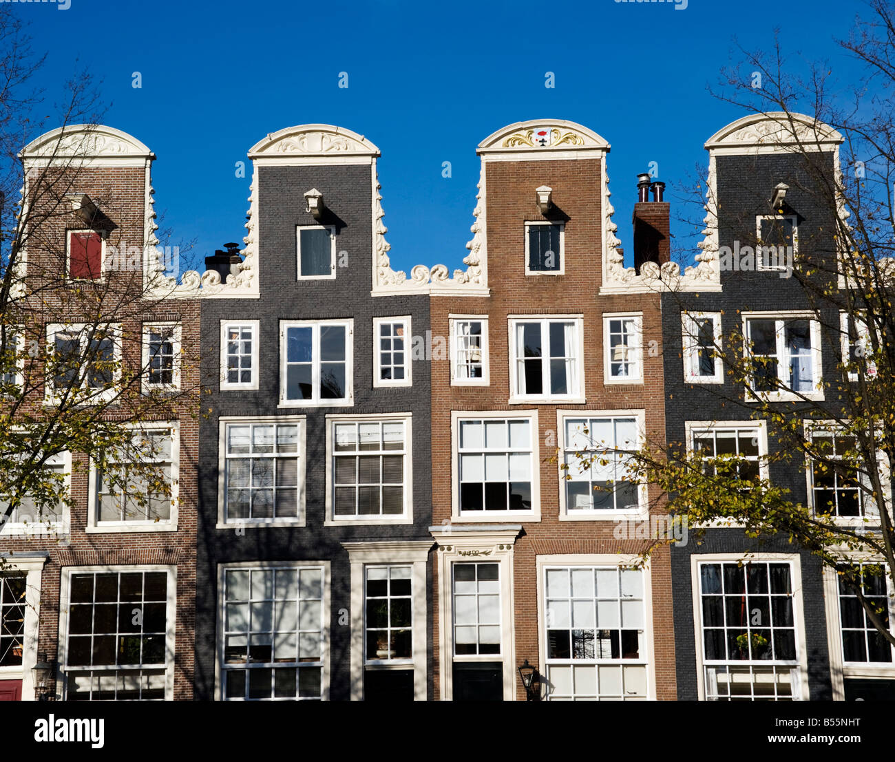 detail of gable roofs on old historic houses in  Amsterdam Netherlands 2008 - Stock Image