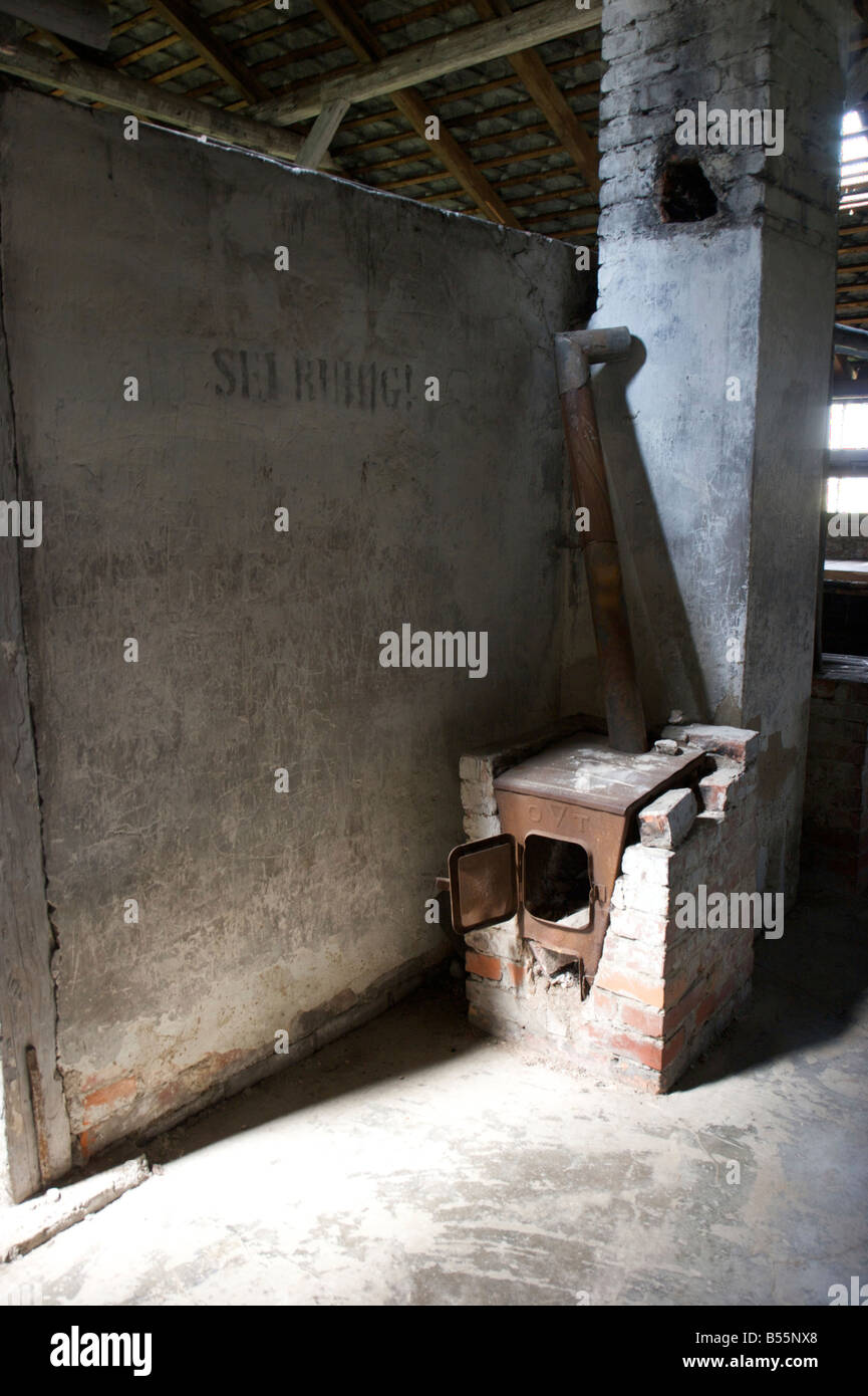 Brick heating oven inside of a prisoners sleeping barrack in former concentration camp Auschwitz II (Birkenau) - Stock Image