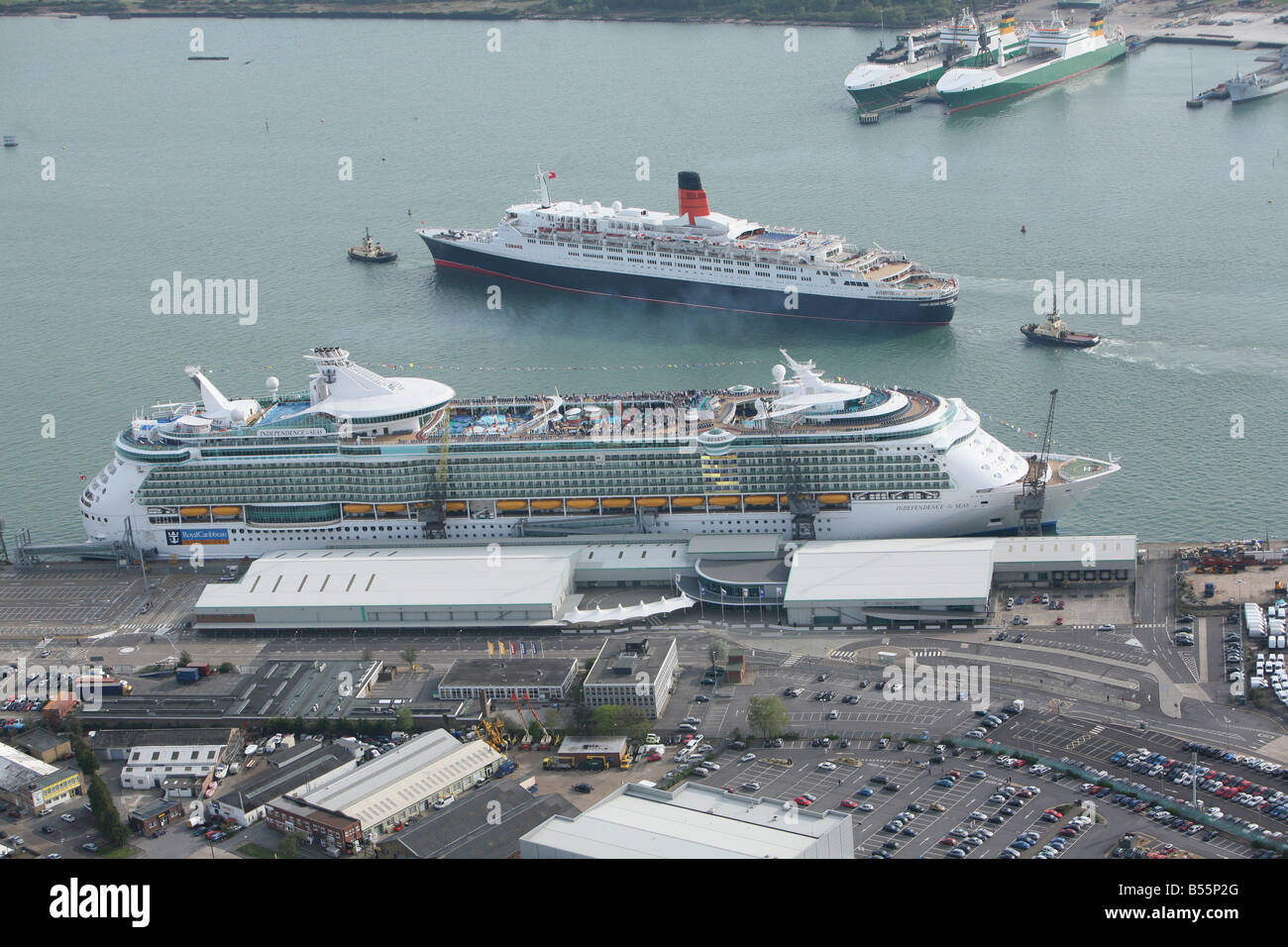 Queen Elisabeth 2 (QE2) passes Independence of the Seas on it's way out of Southampton Docks. Stock Photo