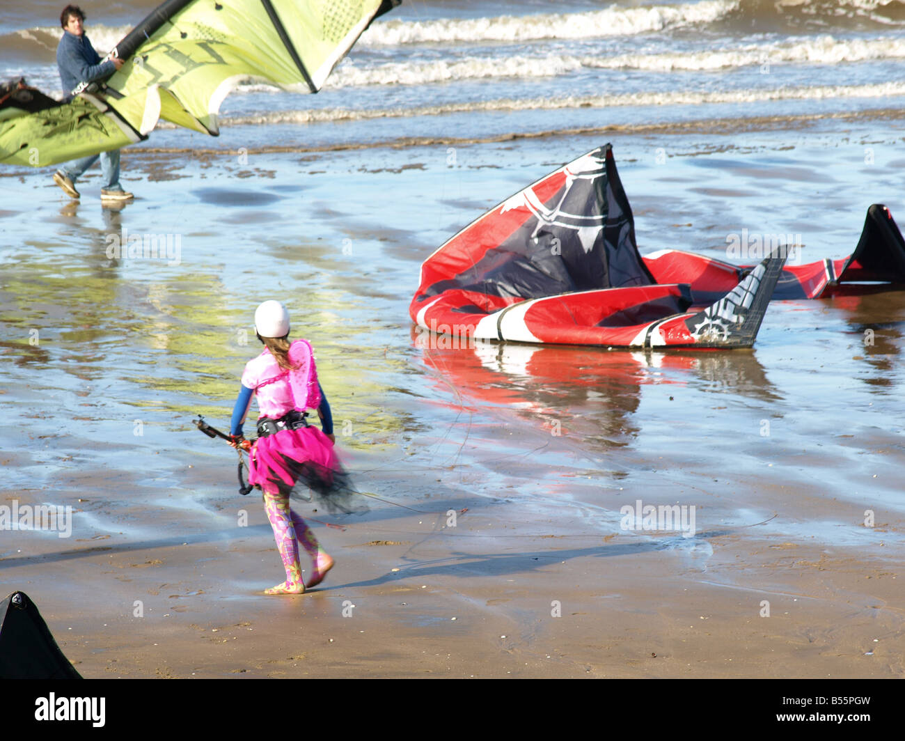 Surfing kites and a girl in fancy dress on the beach at Hunstanton,Norfolk,Easr Anglia,uk. Stock Photo