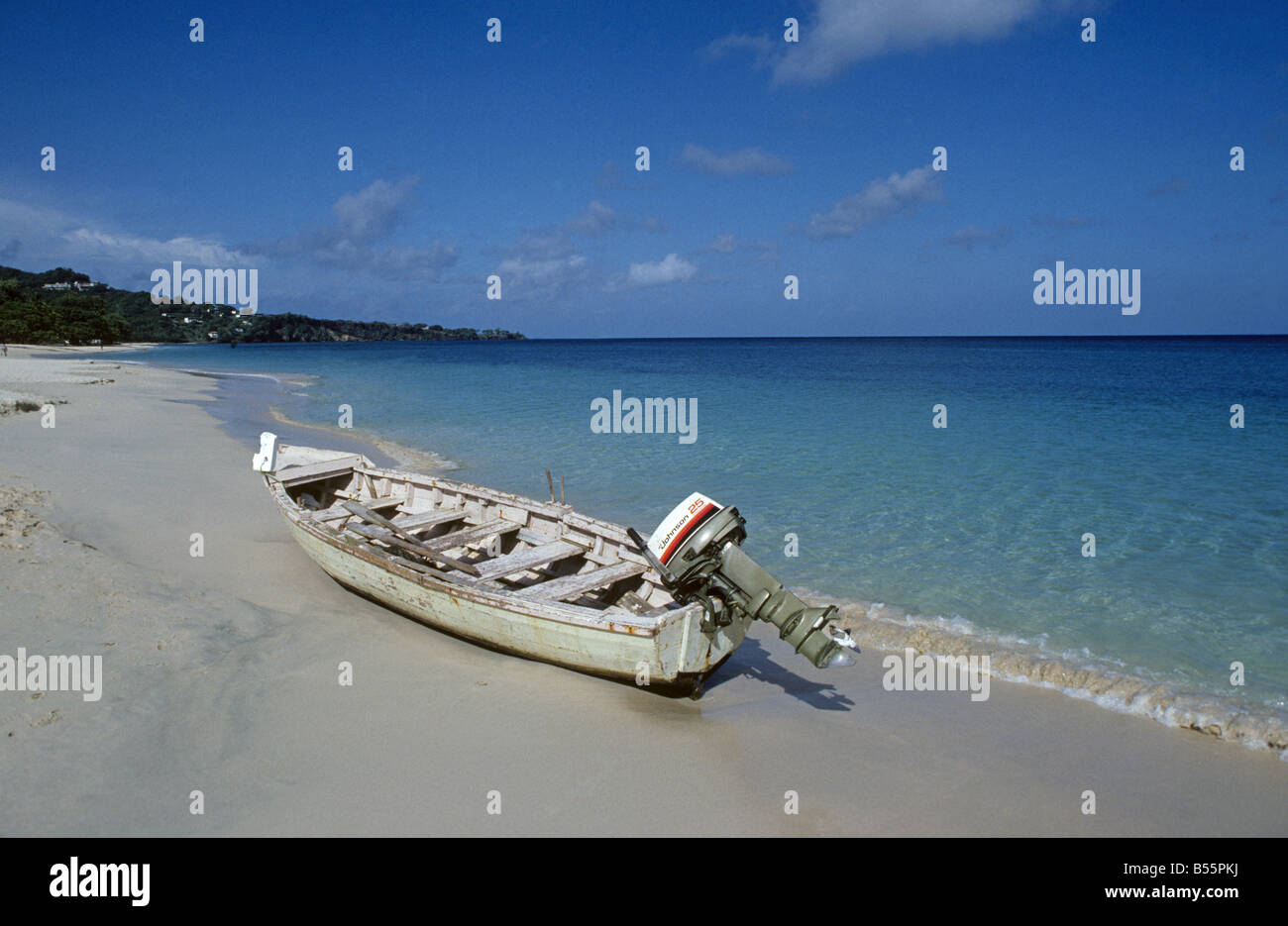 A fishing boat on a beautiful white sand beach on the island of St Thomas Stock Photo