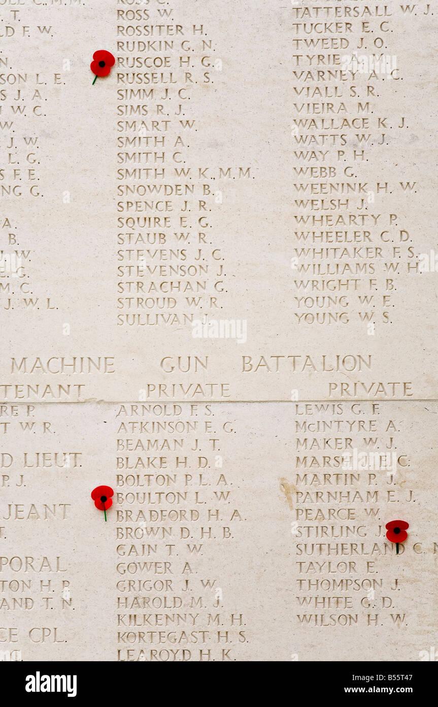 Red poppies on list of war dead from machine gun battalion Tyne Cot British War Memorial cemetery Belgium - Stock Image