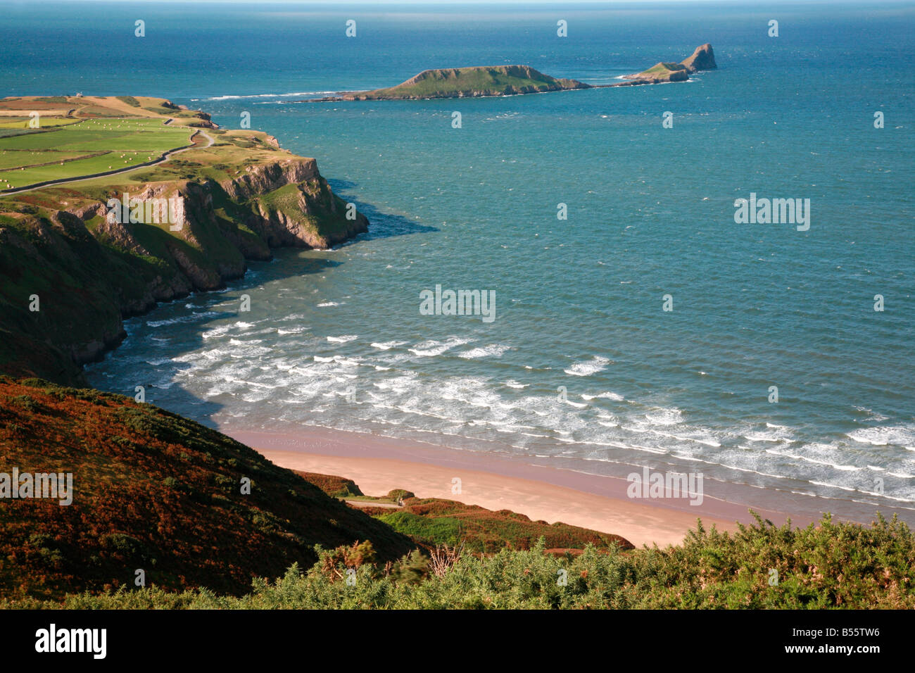 Worm's Head and Rhossili bay from Rhossili Down on the Gower peninsula Wales - Stock Image