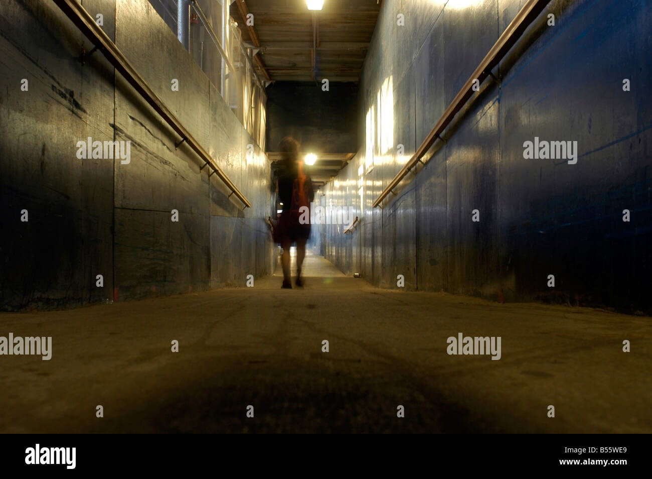 Woman walks along a pedestrian corridor in a construction site in New York Richard B Levine - Stock Image