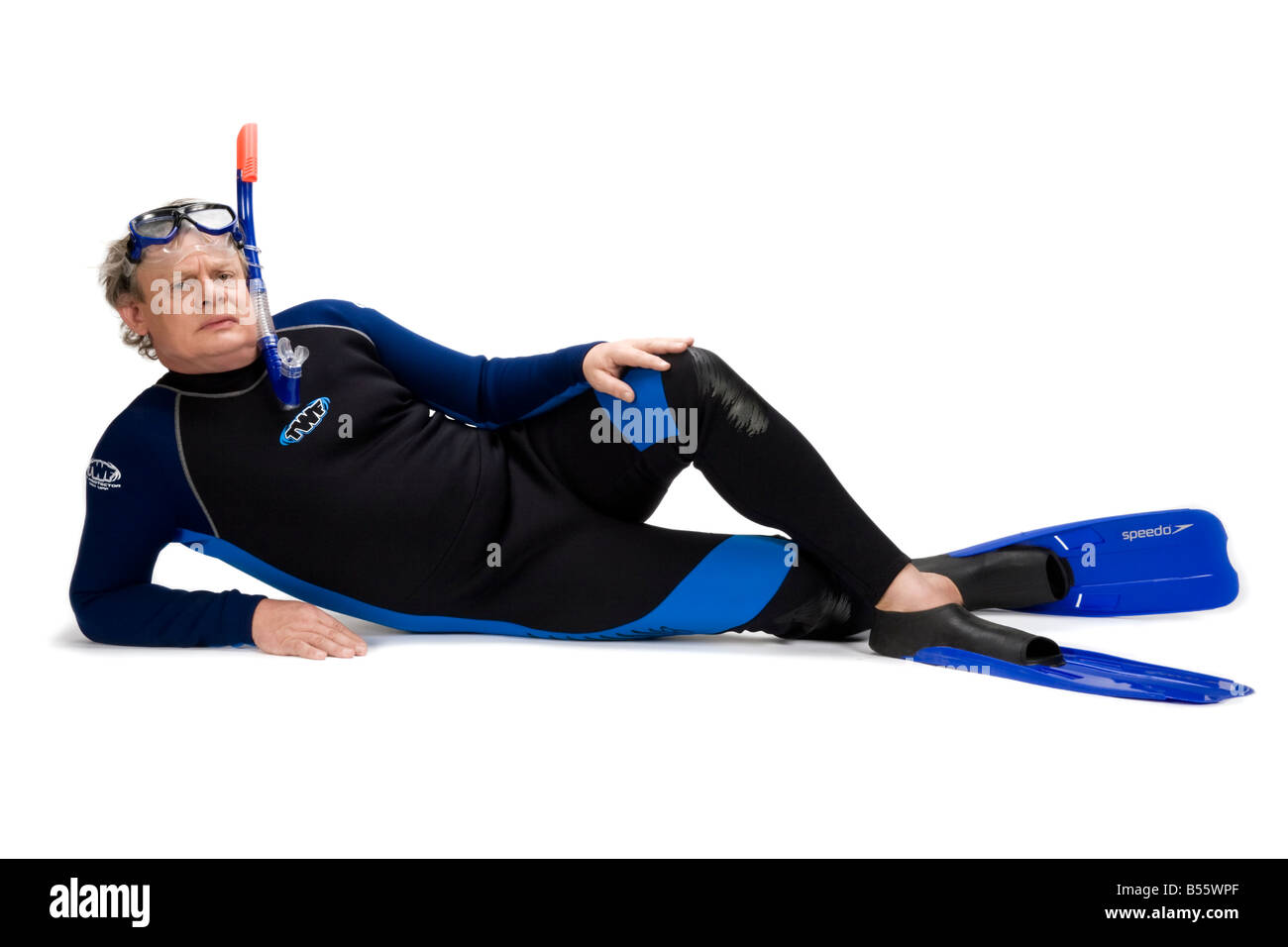 Martin Clunes lying down in a wet suit - Stock Image