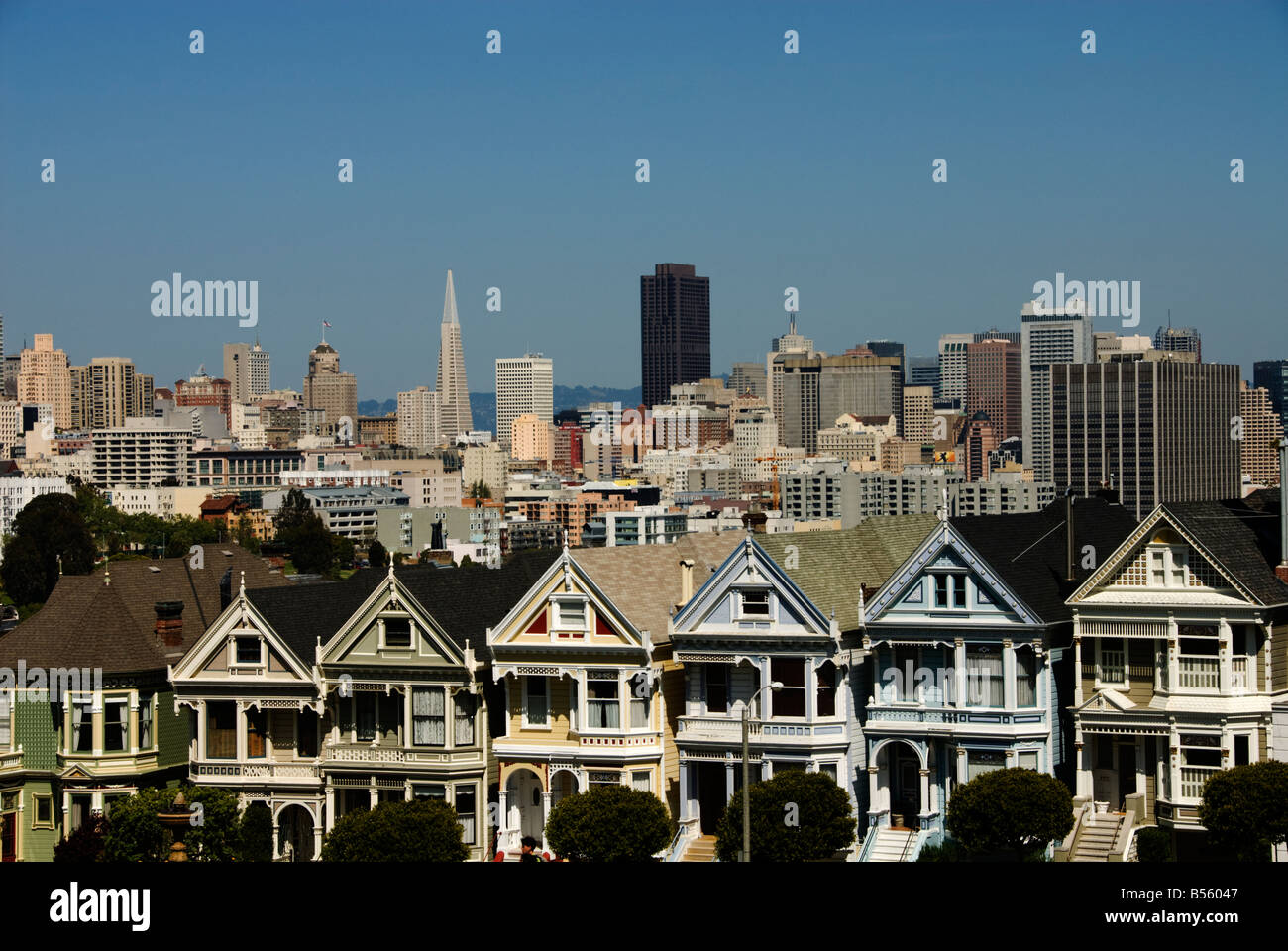 California San Francisco Alamo Square Victorians juxtaposed against the downtown San Francisco skyline. - Stock Image