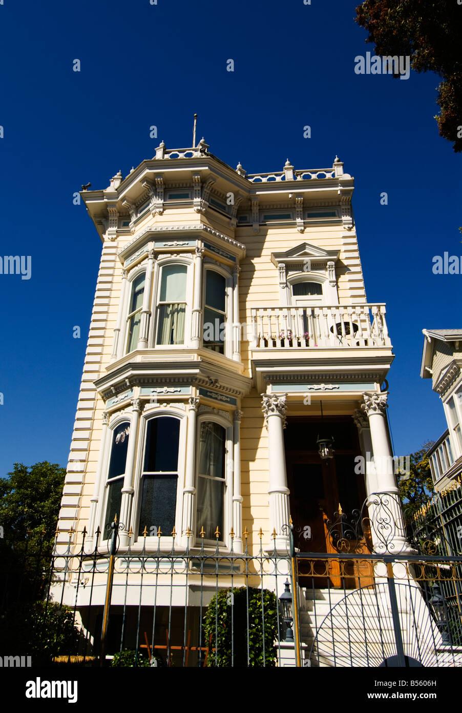 California San Francisco Yellow Victorian house near Divisadero and Sacramento Streets. - Stock Image