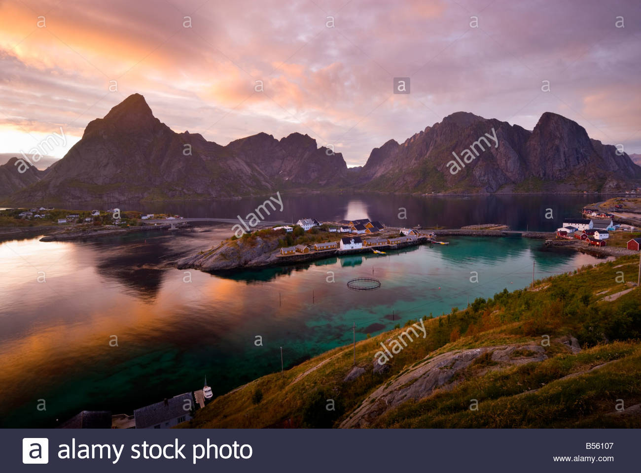 Lofoten Islands, with the hamlet of Sakrisøy, near Reine, in the foreground, Norway. - Stock Image