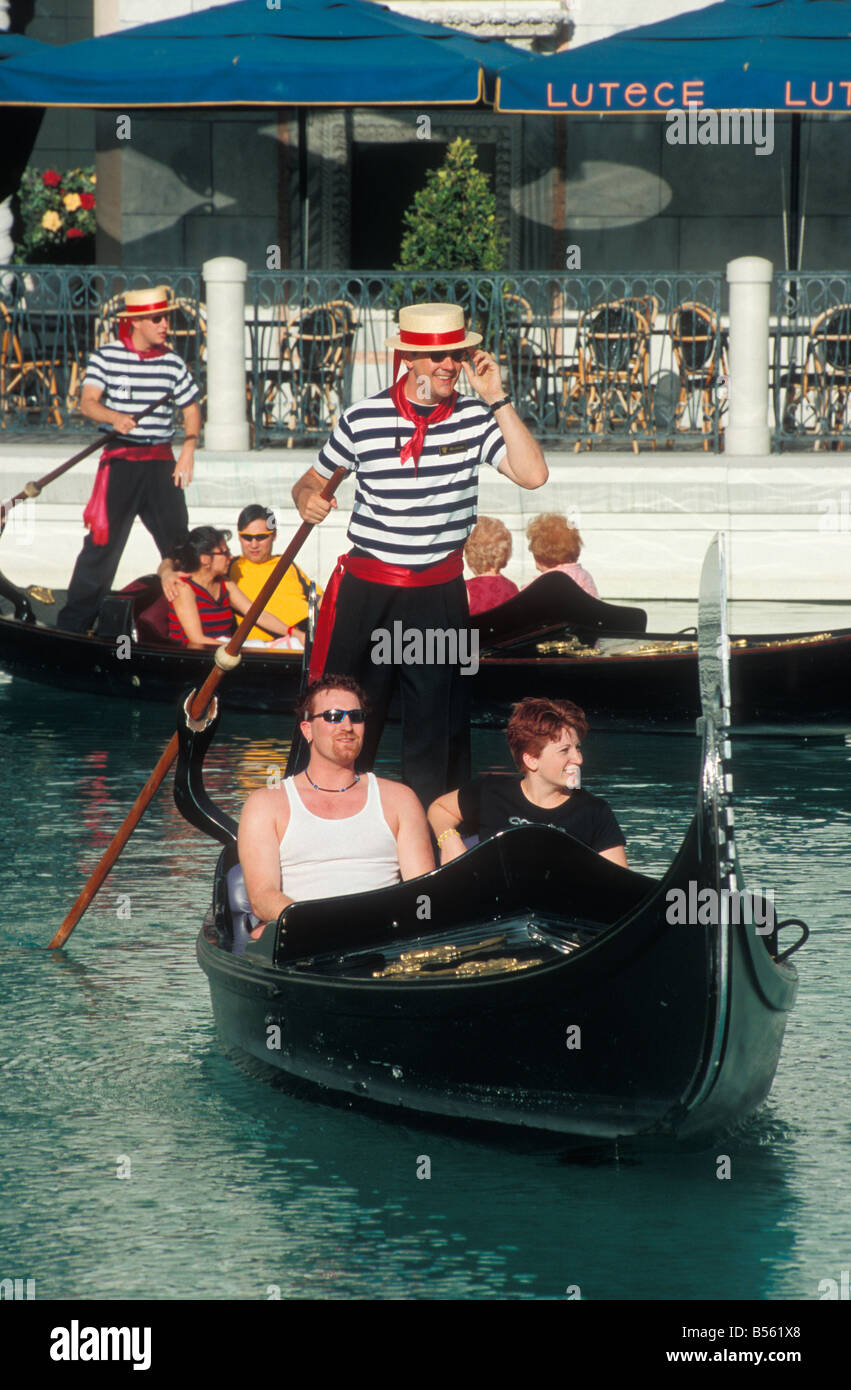 Gondolas with Gondoliers and Guests at Casino The Venetian in Las Vegas Nevada USA - Stock Image