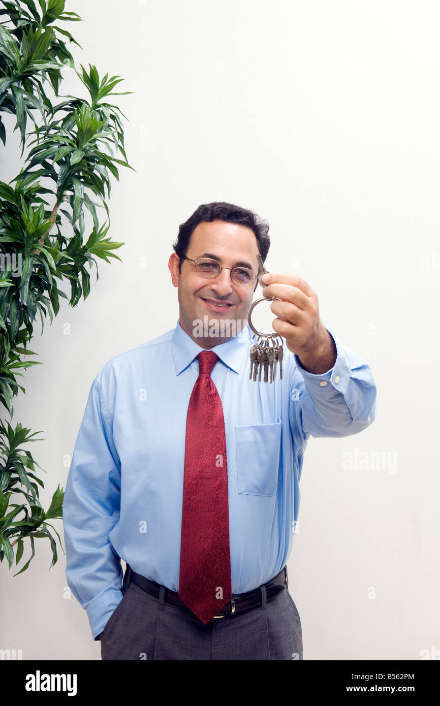 business man keys shirt and tie glasses master key Stock Photo