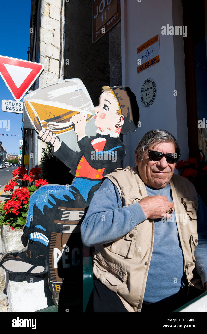 Frenchman awaiting service outside bar, Preuilly-sur-Claise, France. - Stock Image