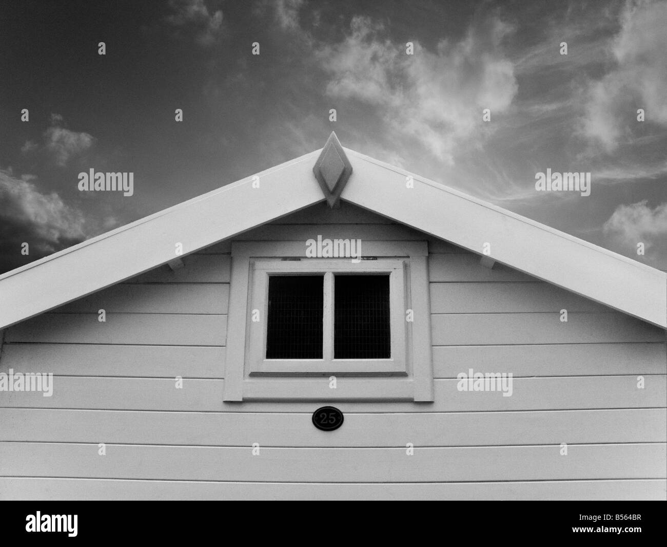 Beach hut looking towards the sky on East Devon Coast in black and white - Stock Image