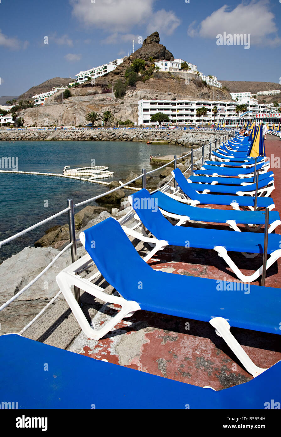 Blue sun loungers Puerto Rico Gran Canaria Spain - Stock Image