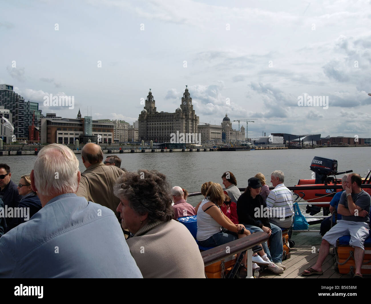 Senior couple enjoying the view on the Mersey Ferry Liverpool UK - Stock Image