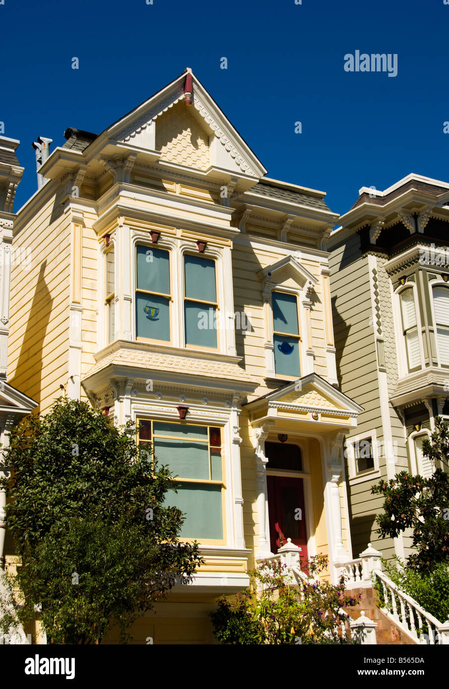 California San Francisco Lovely yellow Victorian House near Laguna and Bush Streets. - Stock Image