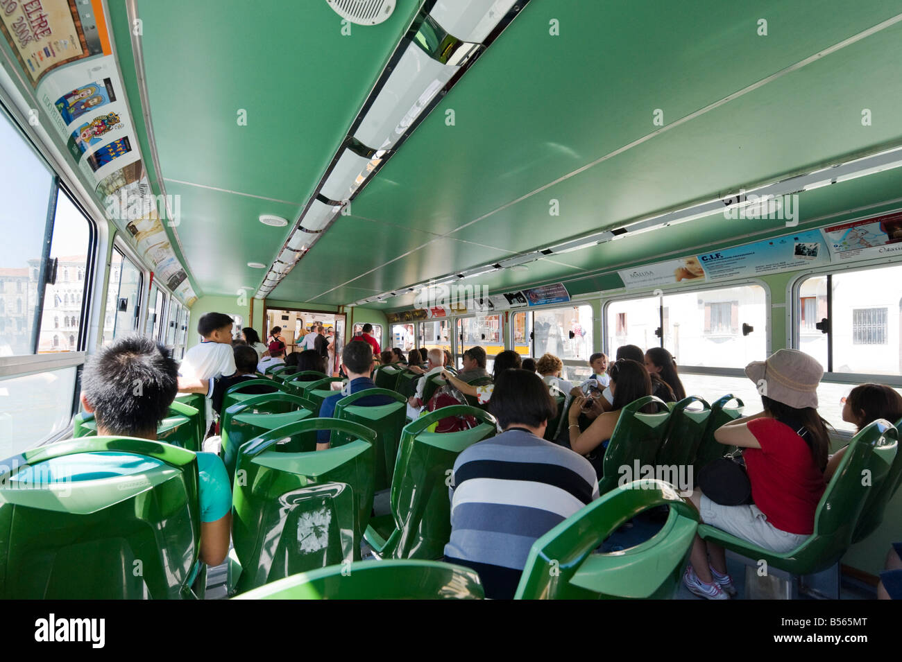 Interior of a vaporetto or water bus on the Grand Canal, Venice, Veneto, Italy - Stock Image
