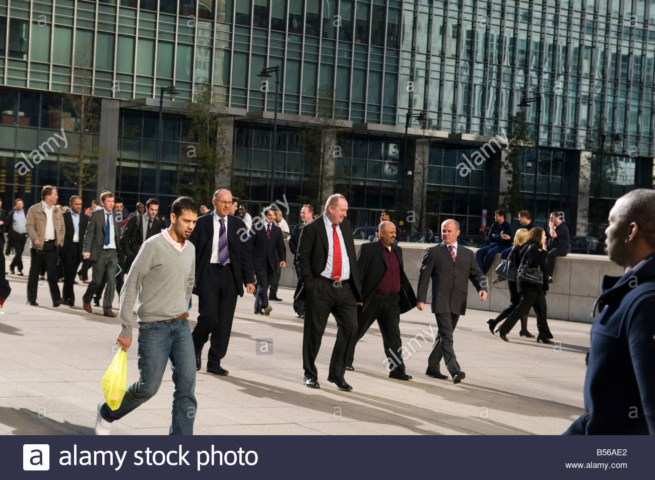 Office workers at lunchtime in Canary Wharf on the Isle of Dogs in London s Docklands Stock Photo