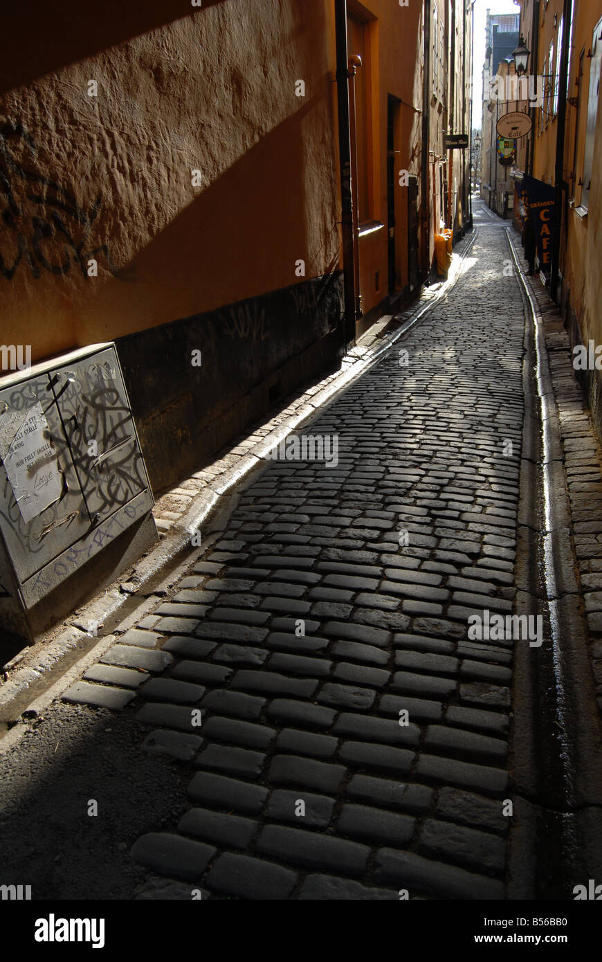 Shimmering Cobblestones in a street in Stockholm in the brisk sunshine in a Wintery Afternoon, Sweden, Scandinavia, - Stock Image