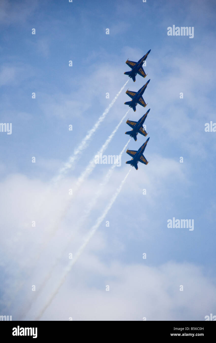 The elite US Navy Blue Angels speed in formation at hundreds of miles per hour at the 2008 Joint Service Open House - Stock Image