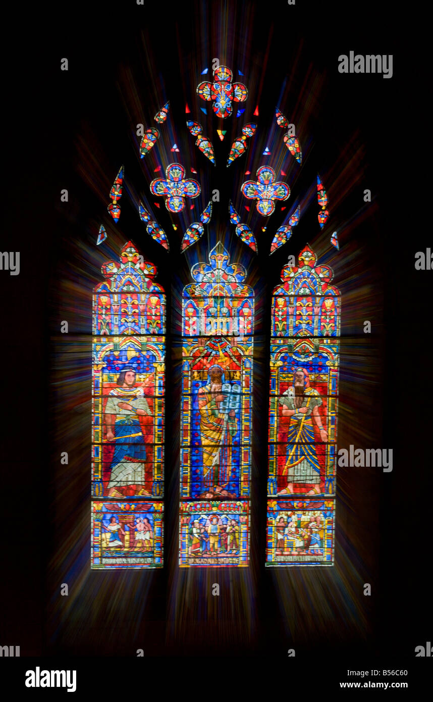 Zoom burst of a stained glass window in the Washington National Cathedral in Washington DC - Stock Image