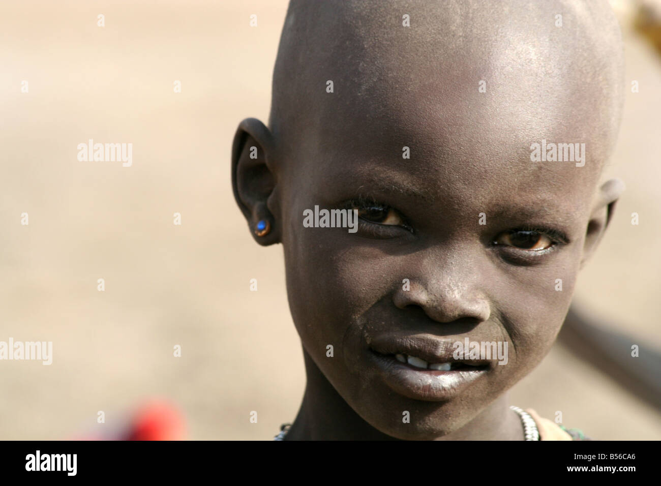 A Dinka girl near Akot South Sudan grows up in a cattle camp of hundreds thousands of cows - Stock Image