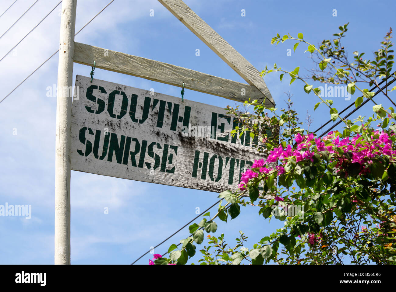 South End Sunrise Hotel wooden sign and bougainvillea on Big Corn Island, Nicaragua, Central America Stock Photo