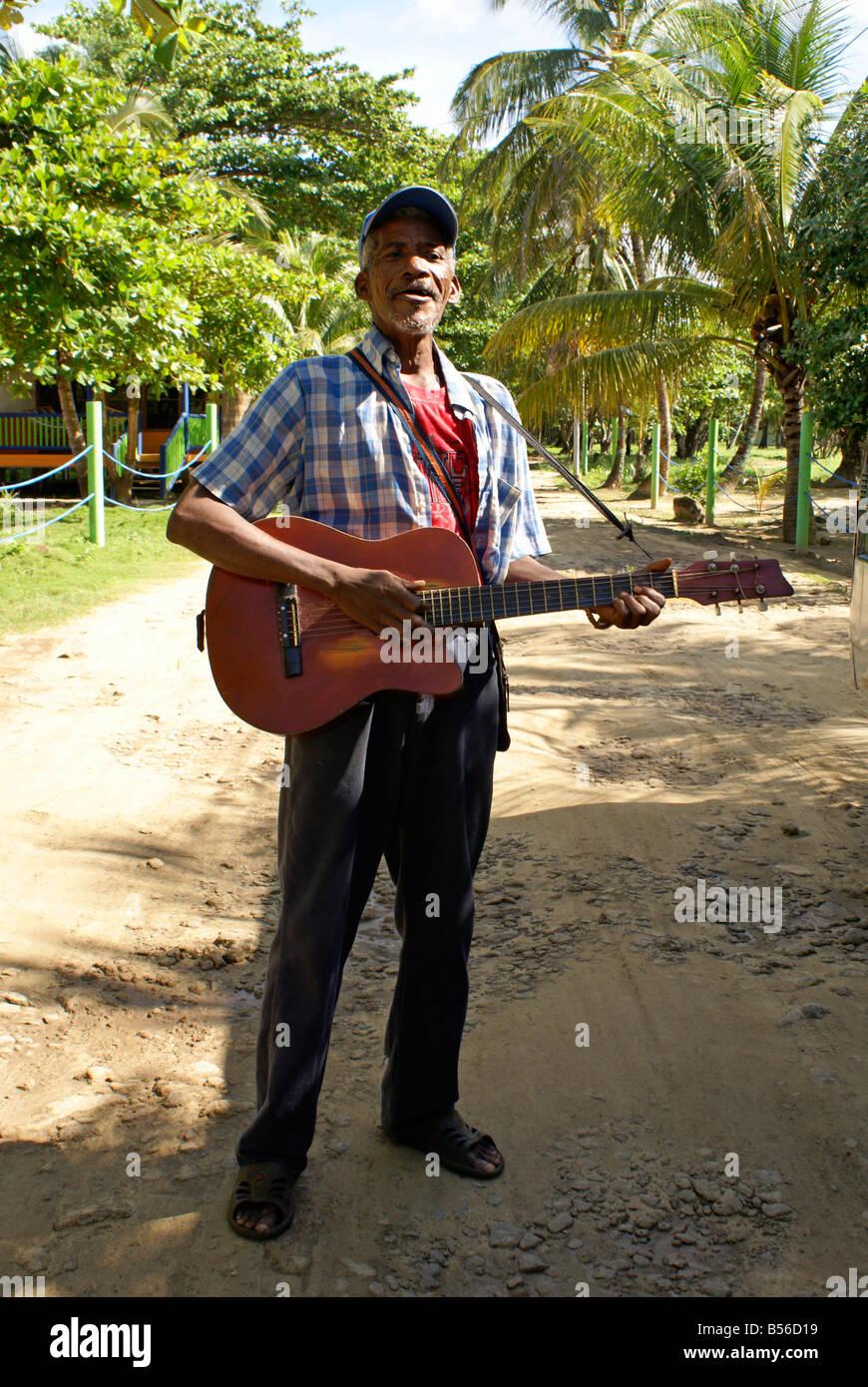 Black Nicaraguan man playing the guitar and singing on Big Corn Island, Nicaragua, Central America Stock Photo