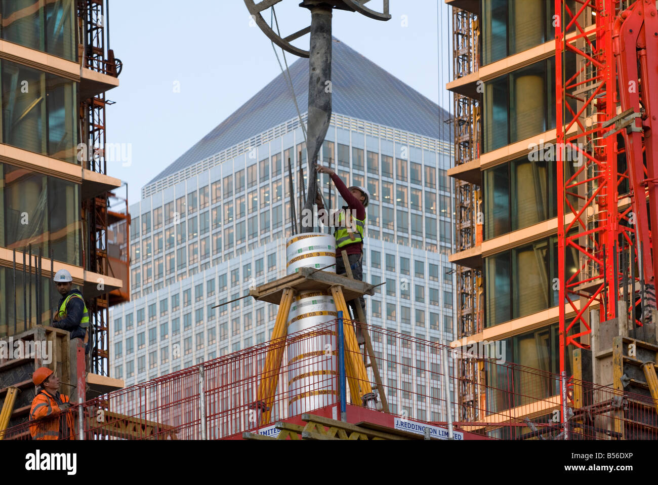 Concrete being pored The Landmark E14 apartments Canary Wharf London under construction. - Stock Image