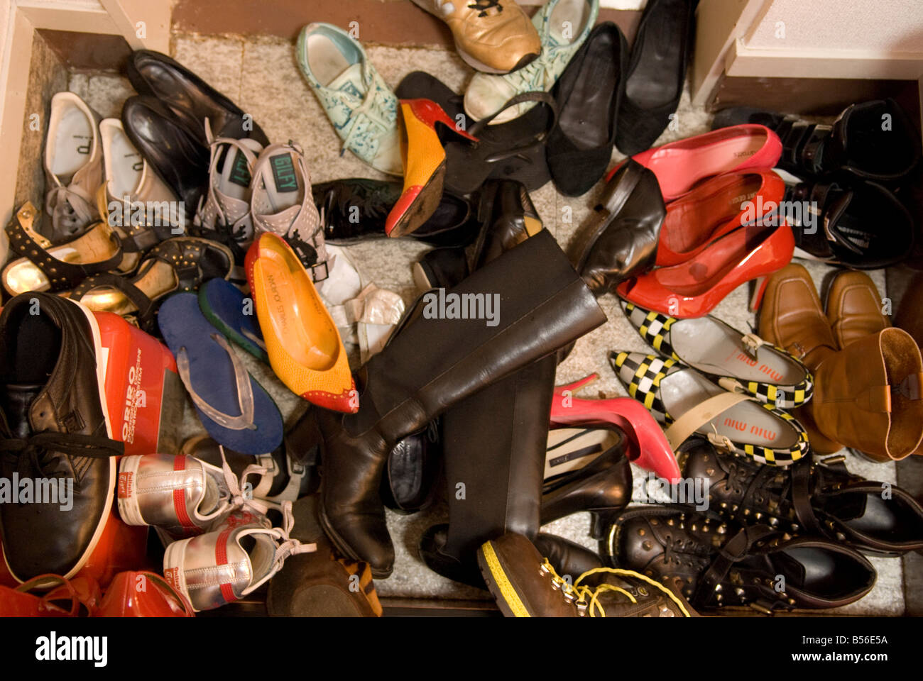 Shoes at a party in Tokyo. - Stock Image