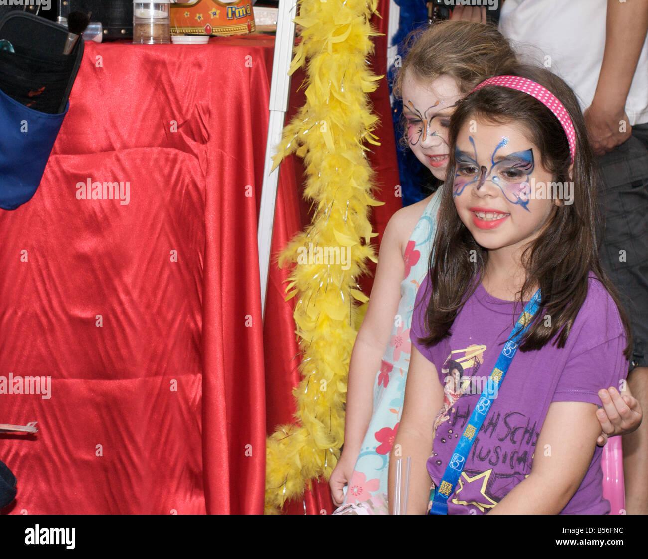 Girls with painted faces at the Lan Kwai Fong carnival, Hong Kong - Stock Image