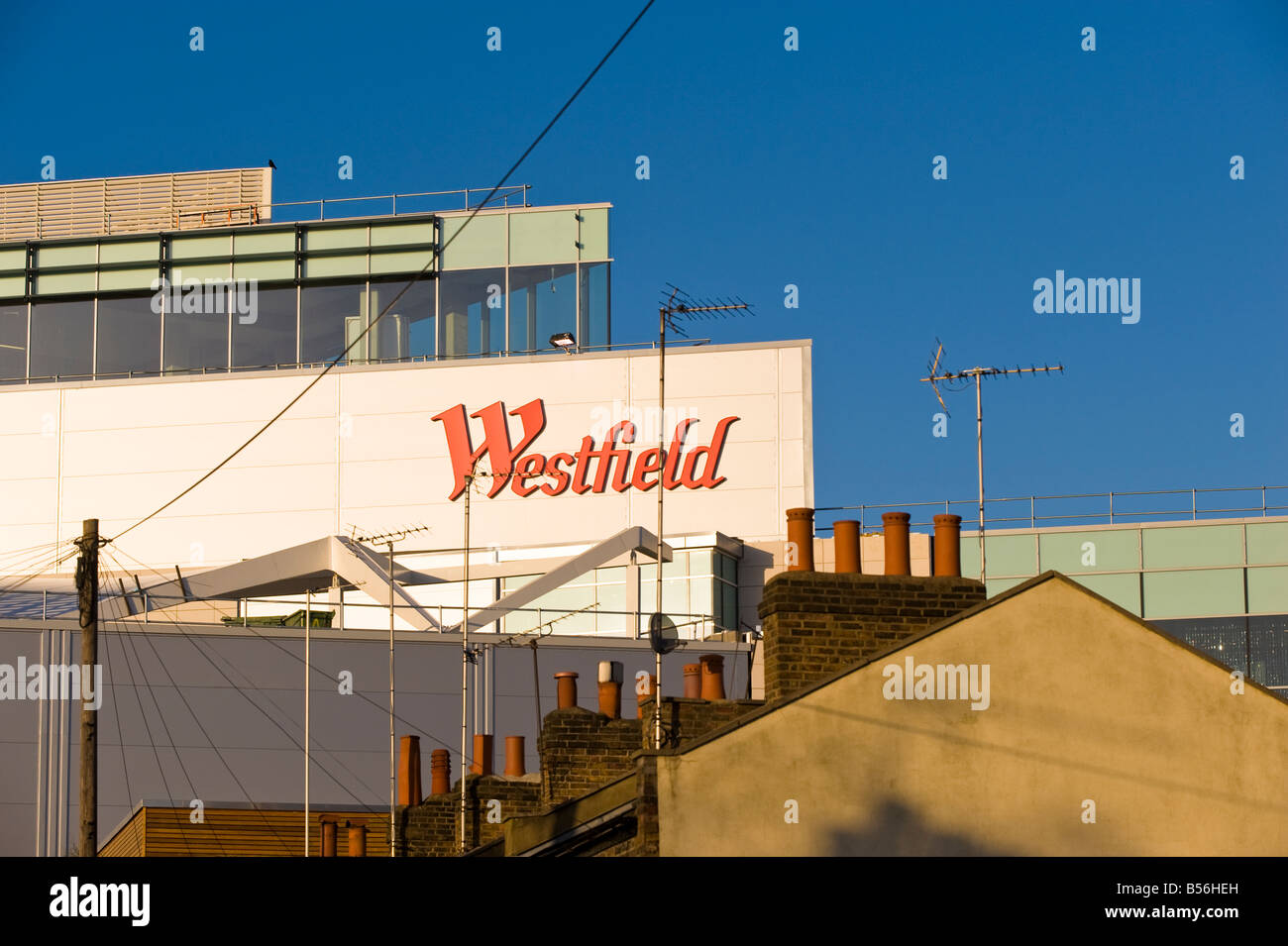 Modern facade of newly built Westfield Shopping Centre and traditional Shepherd s Bush architecture London United - Stock Image