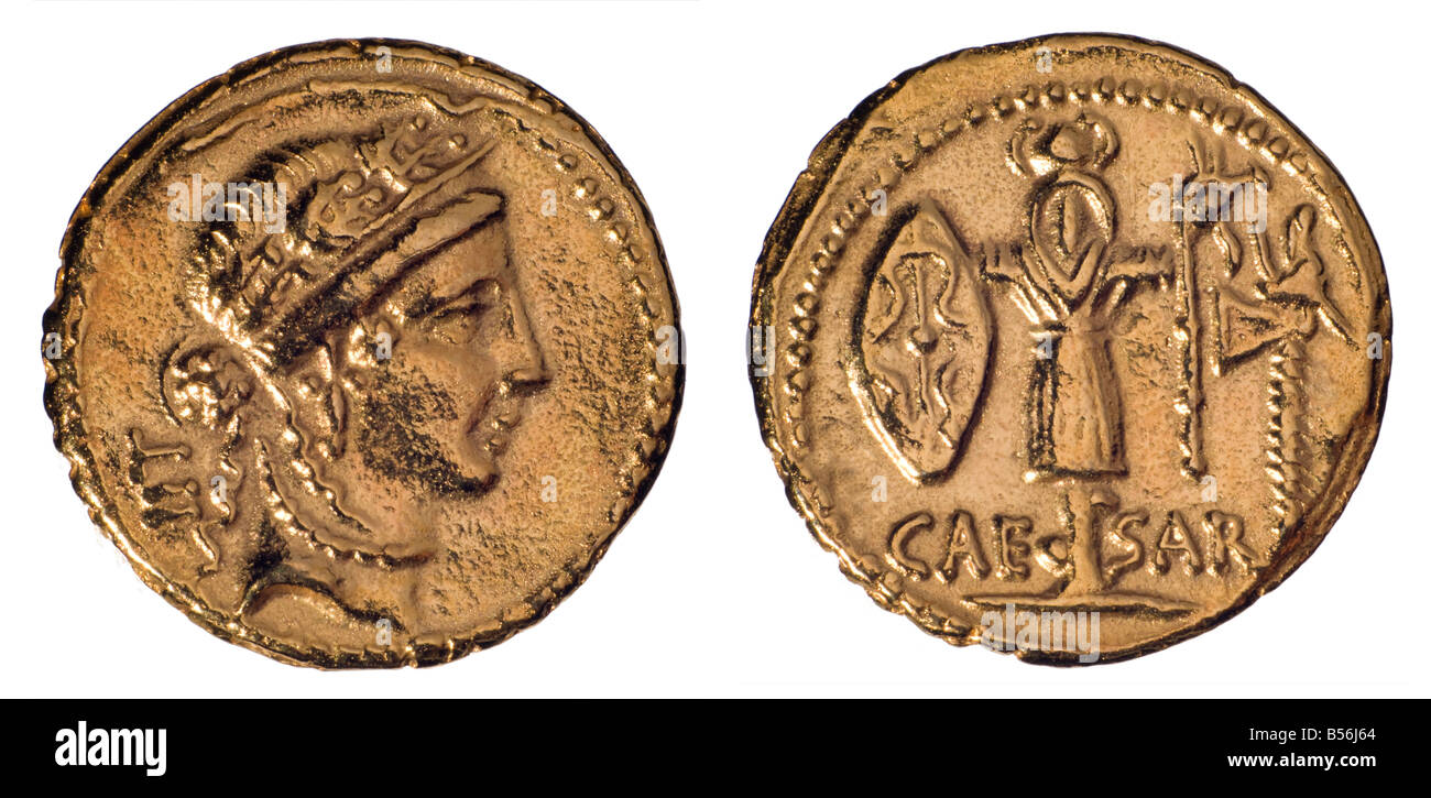 Gold Roman Aureus Coin (replica). Julius Caesar, 48-47BC. Obverse: Female head, probably Venus. Reverse: Trophy - Stock Image
