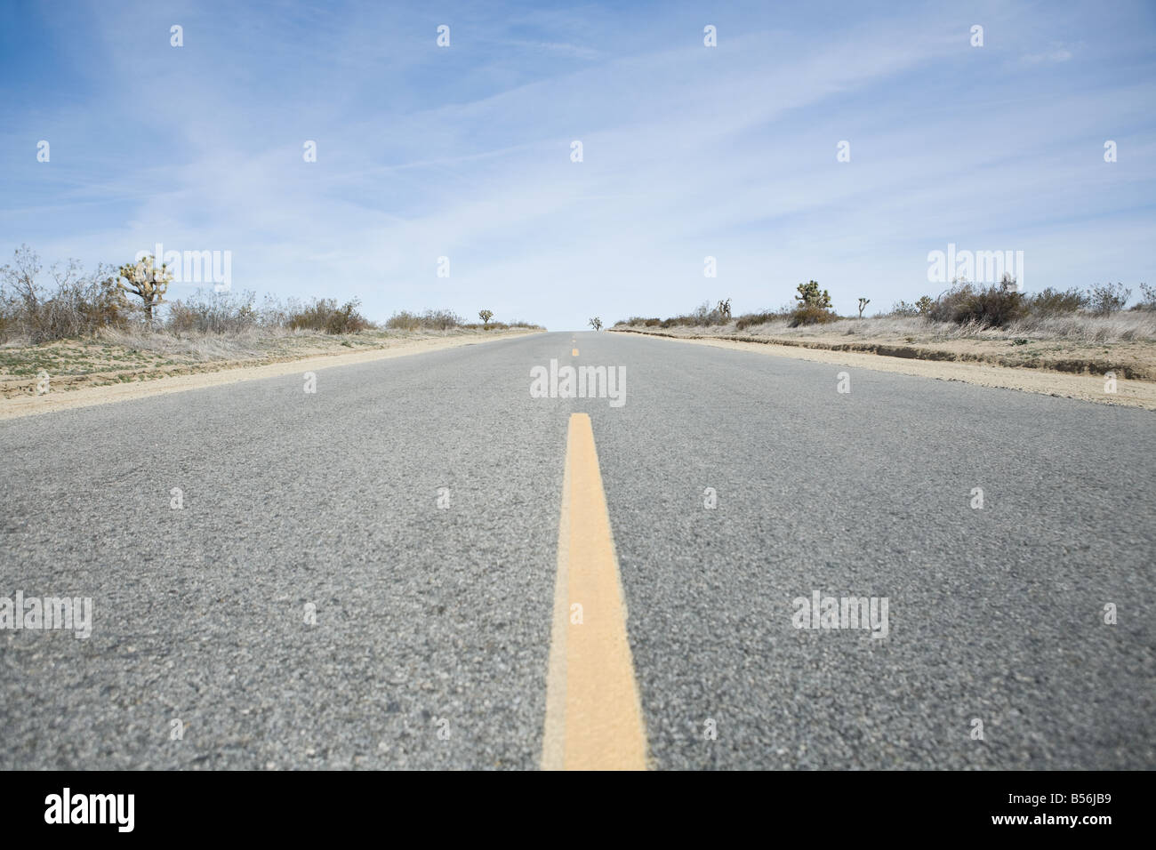 Highway through the Californian salt flats - Stock Image