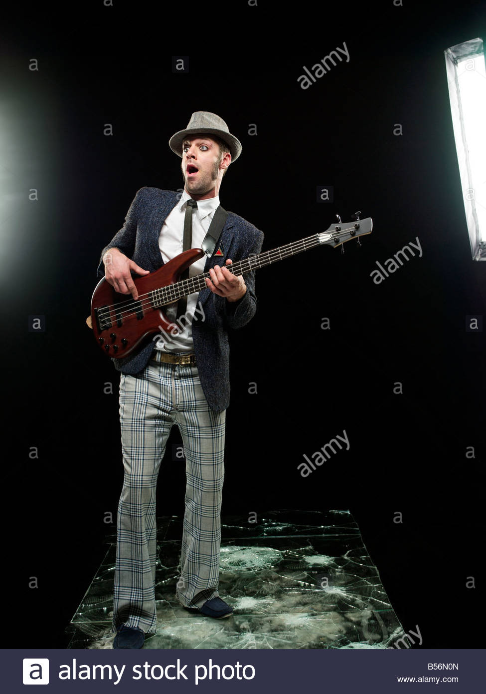 A guitarist playing a guitar - Stock Image