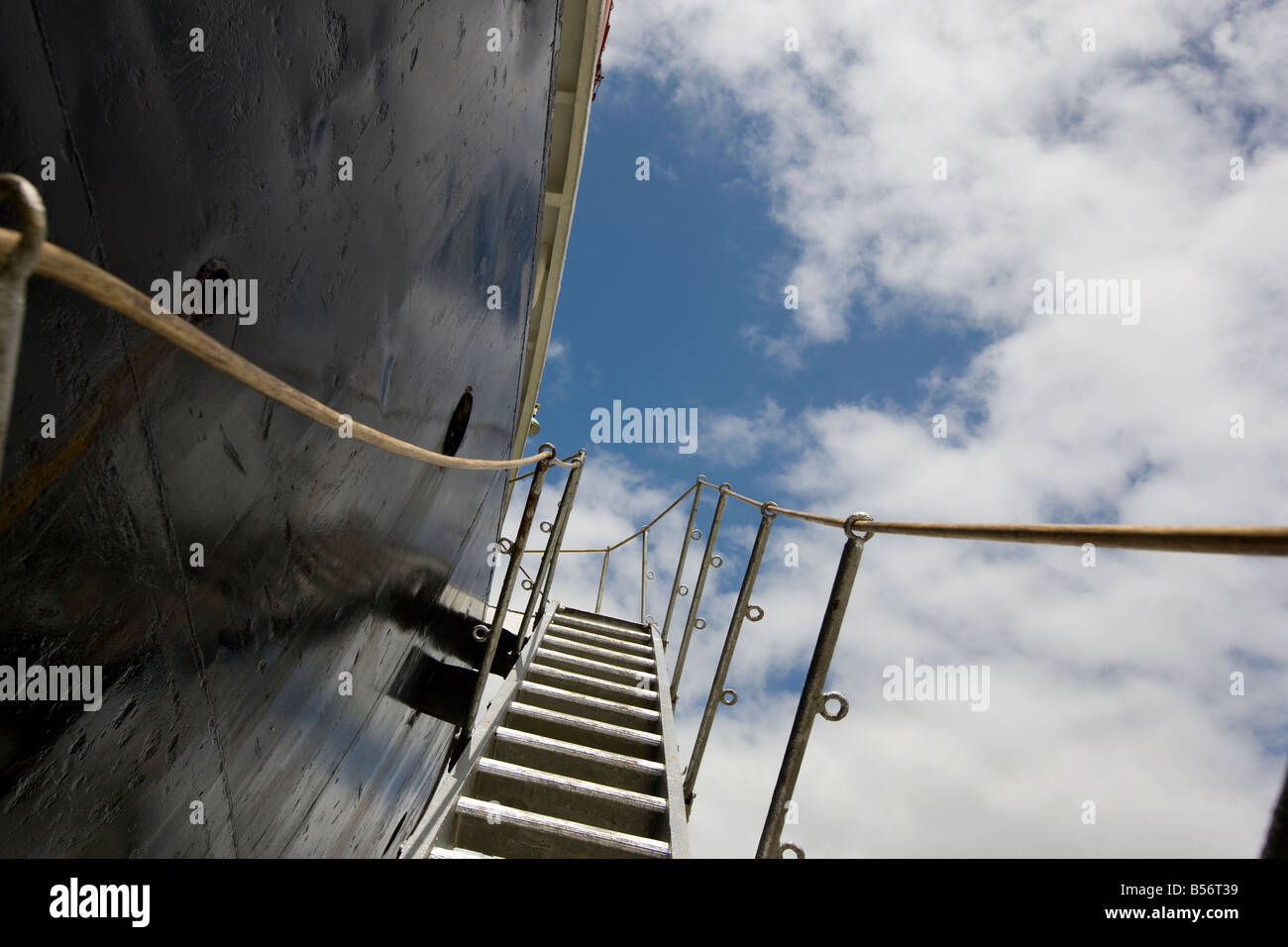 stairs leading to ship, on the side of a ship hull. - Stock Image