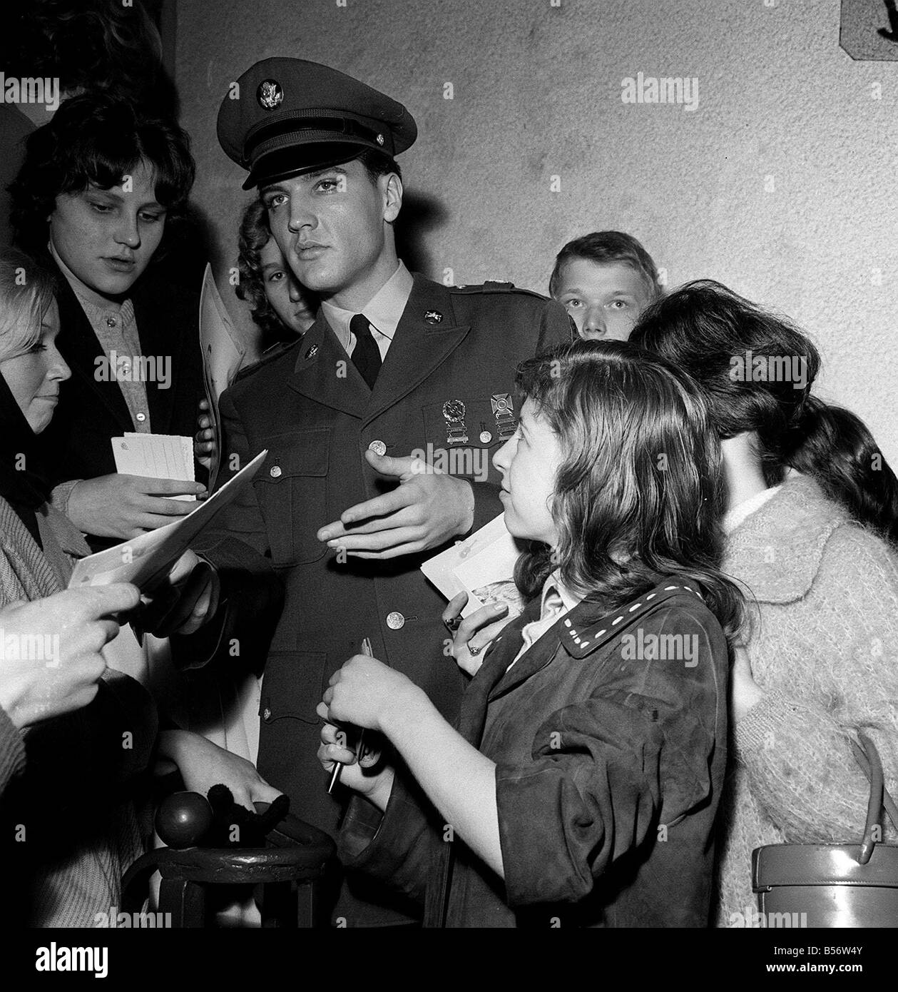 Elvis Presley signs autographs at press conference Germany March 1960 - Stock Image