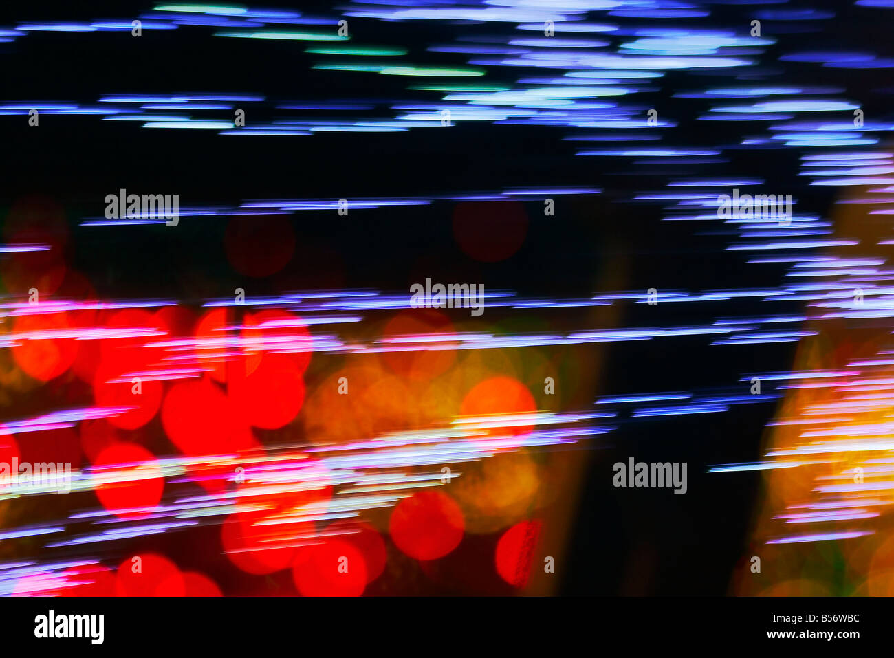 Christmas lights at the Mormon Temple Festival of Lights reflected in the body of a black parked car Stock Photo