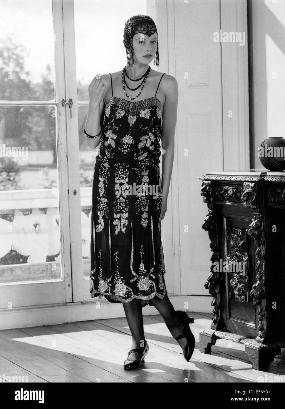 1920s fashions beaded flapper dress and skull cap with