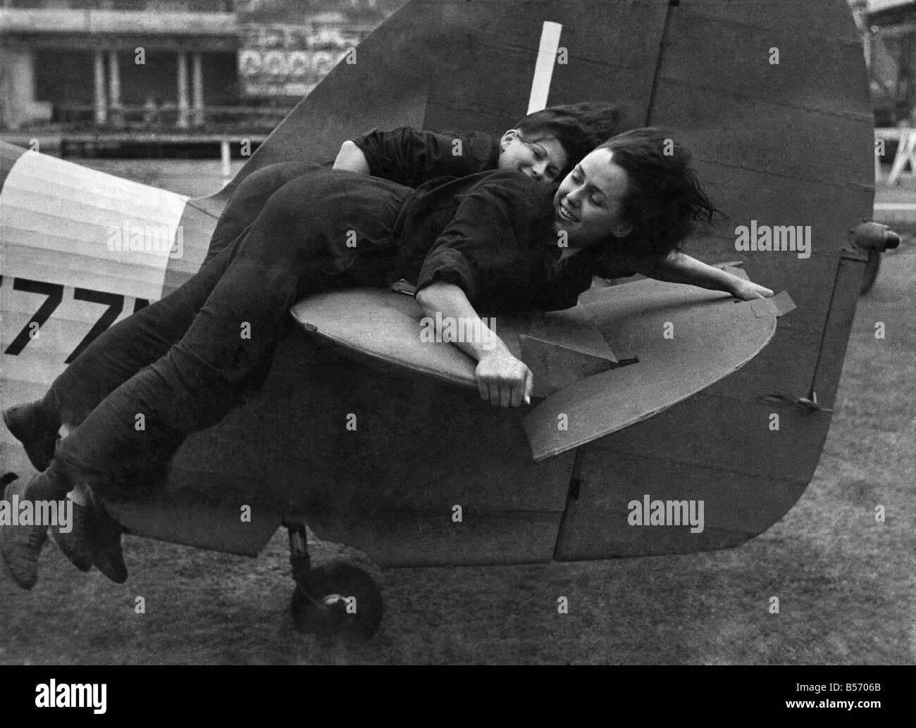 World War II: Women. WAAF girl mechanics lying on the tail of a Hurricane fighter. June 1943 P010252 - Stock Image