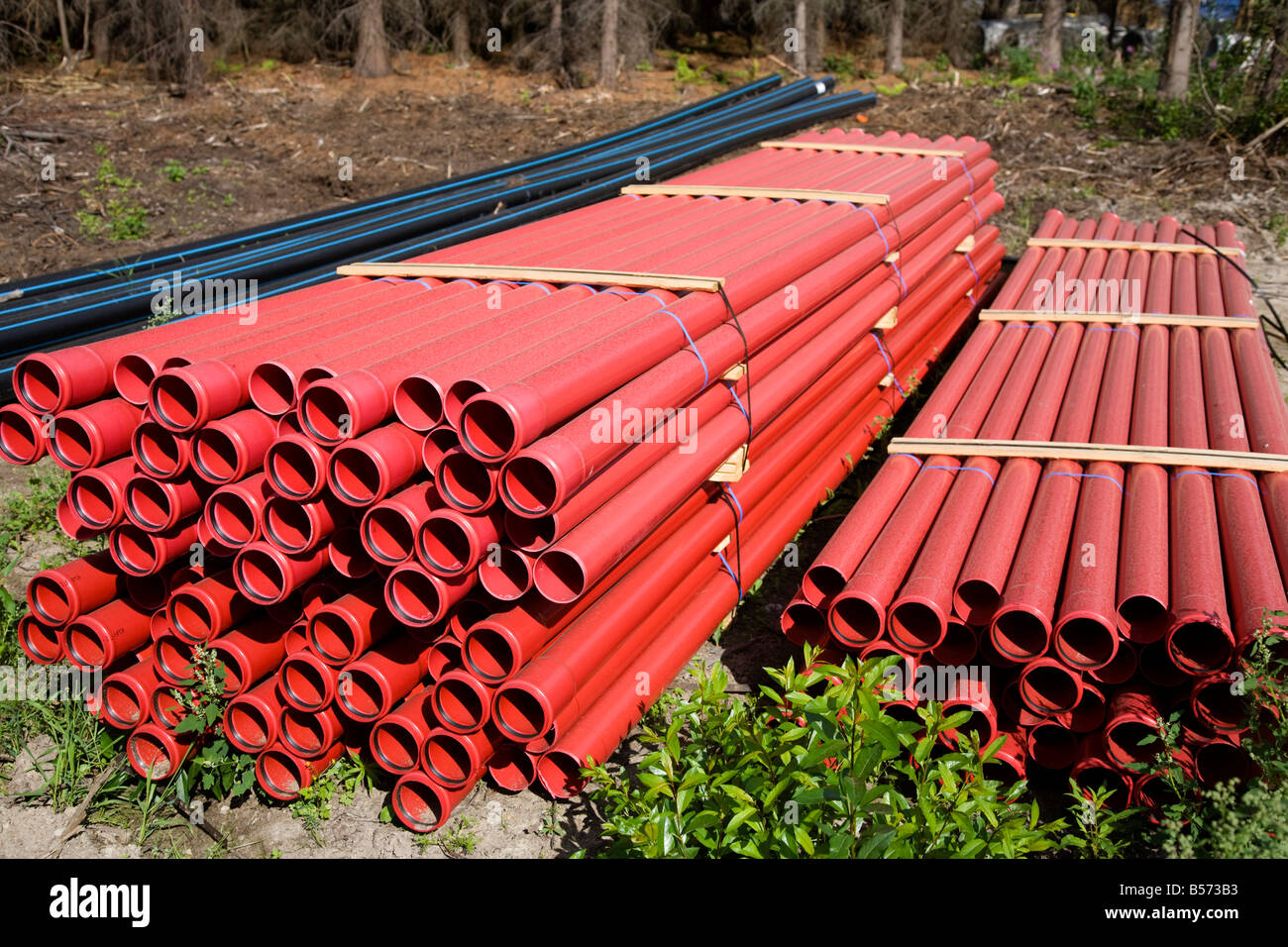 Piles of red drainage pipes , Finland Stock Photo