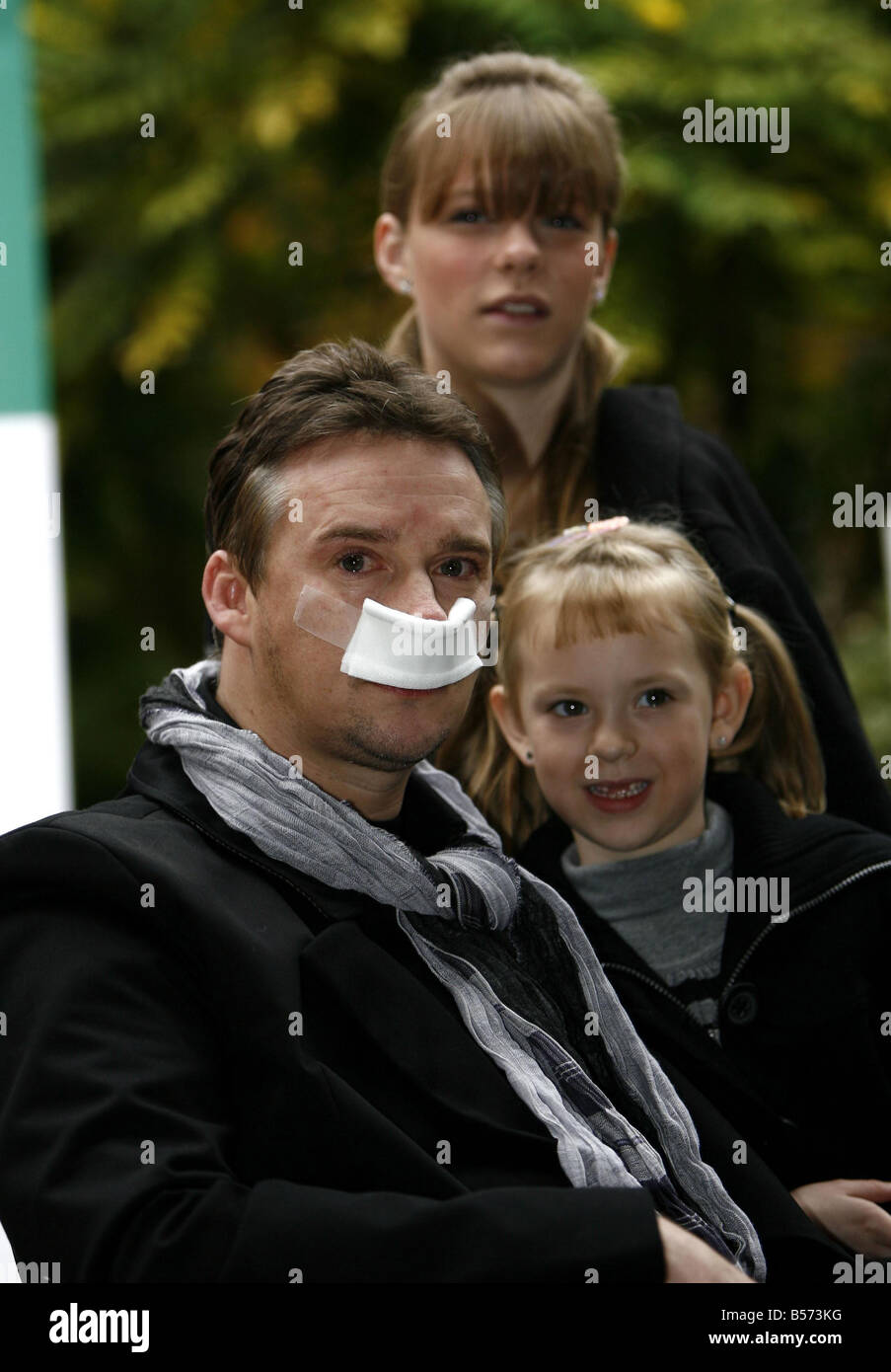 Russell Watson looking tearful leaves the Alexandra Hospital Cheadle with his daughters Hannah and Rebecca - Stock Image