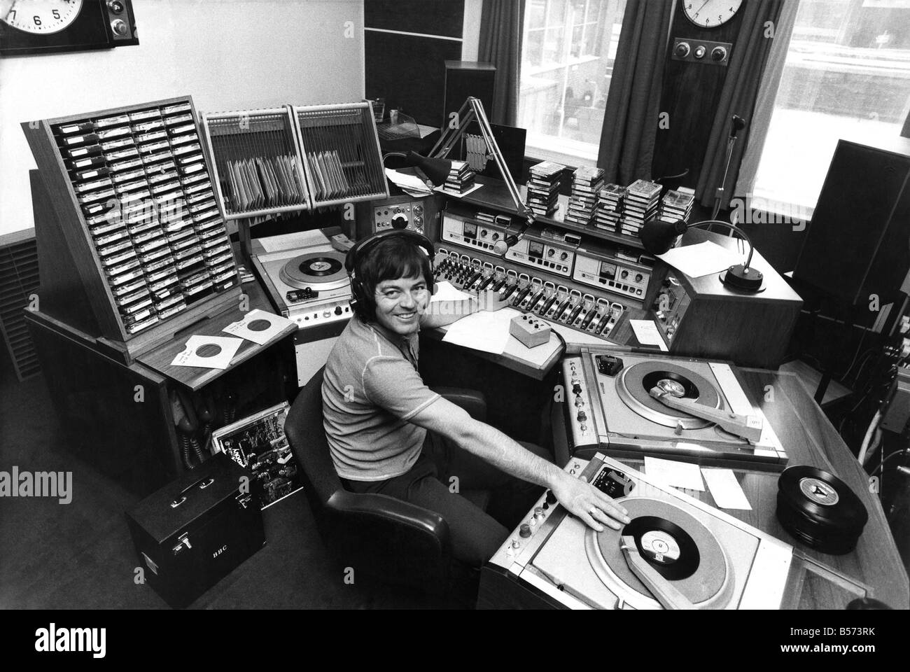 Radio I disc-jockey Tony Blackburn at the studio console equipped with all the tricks of his trade. June 1973 P003821 Stock Photo
