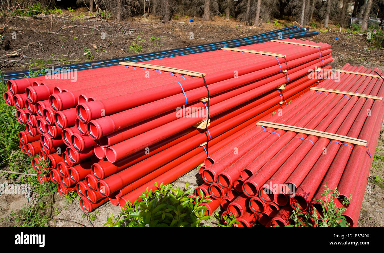 Pile of red drainage pipes , Finland Stock Photo