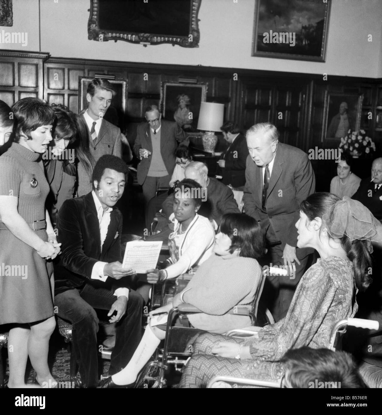 Prime Minister Harold Wilson seen here with his wife Mary atttending a carol concert performed by television celebrities - Stock Image