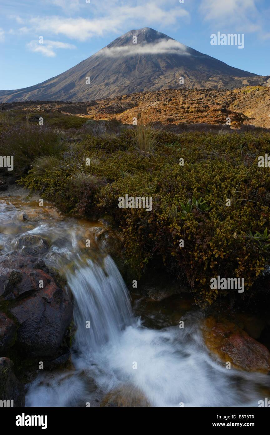 Stream waterfall in front of Mt Ngauruhoe in Tongariro Crossing Tongariro National Park Ruapehu North Island New - Stock Image
