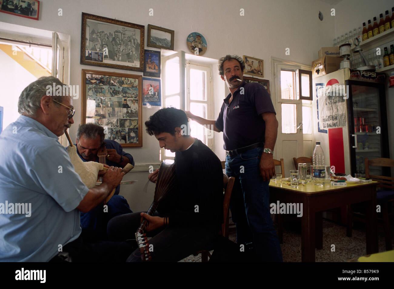 greece, dodecanese islands, karpathos, olymbos, kafenion, greek men playing traditional music Stock Photo