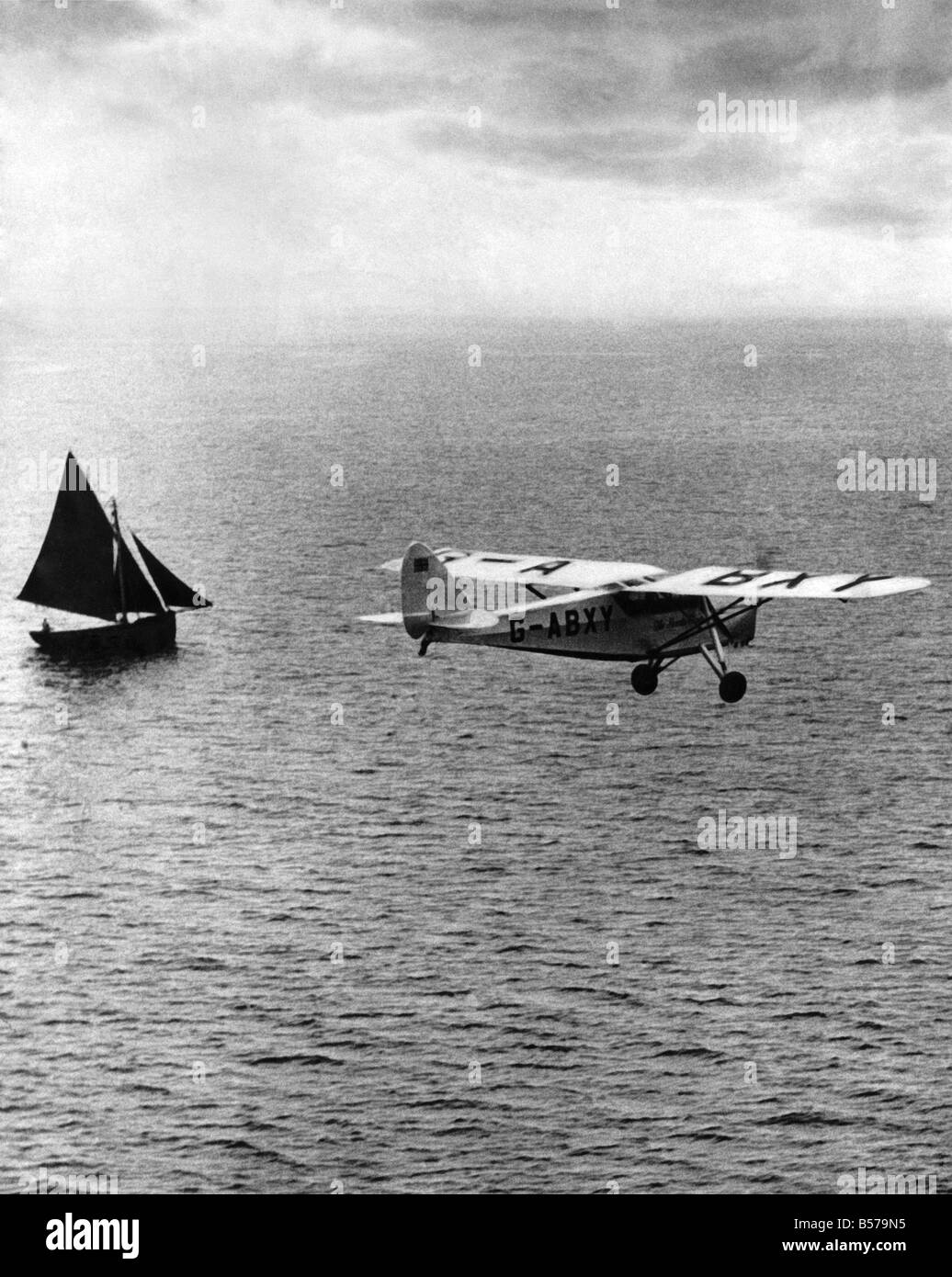 The De Havilland D.H.80A Puss Moth The HeartÕs Content with a D.H. Gipsy Major engine is pictured over the AtlanticStock Photo