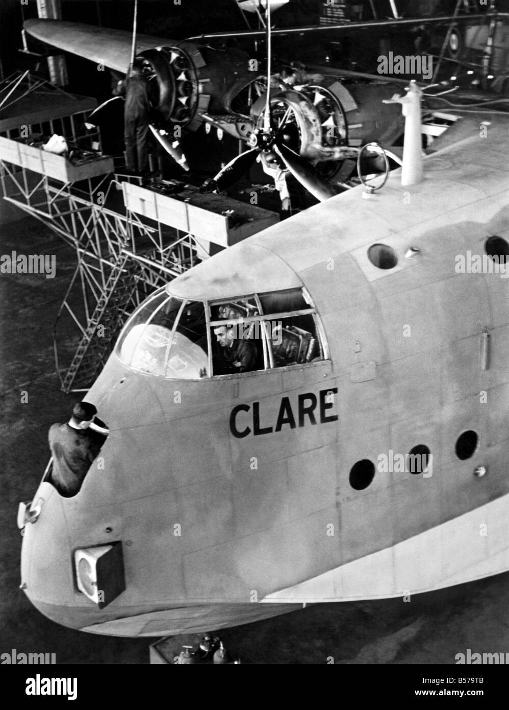 The transatlantic flying boat Clare is overhauled after her strenuous journeys, before being transferred to new Empire routes. November 1940 P004813 Stock Photo
