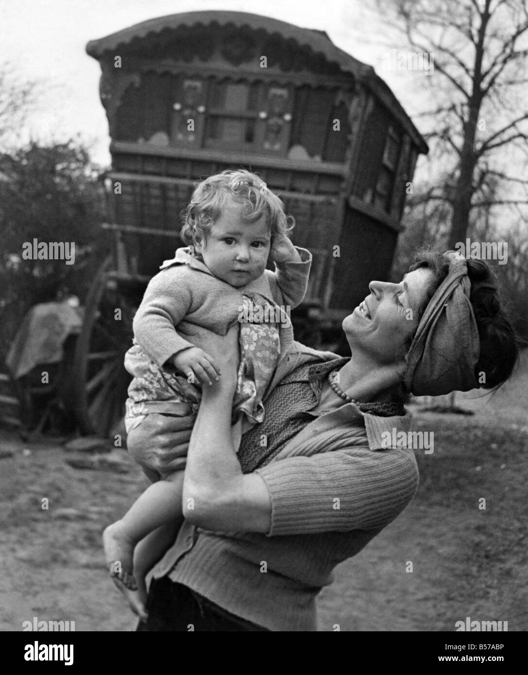 Gypsy woman with child pose outside their caravan.  July 1944 P007205 - Stock Image